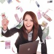Businesswomen with group of money and laptop. — Stock Photo #5736525