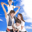 Happy family. Blue sky, white cloud. — Stok fotoğraf
