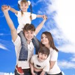 Happy family. Blue sky, white cloud. — Stock Photo