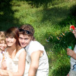 Family with children outdoor. — Stock Photo