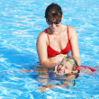 Child learn swim in swimming pool. — Stock Photo #5736563