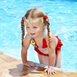 Stock Photo: Child swimming in pool.