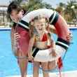 Child with mother near swimming pool. — Stok fotoğraf
