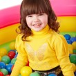Happy child in group colourful ball. — Foto Stock