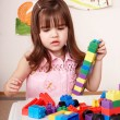 Child playing construction set in play room. — Stock Photo