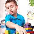 Child playing lego block and construction set. — Stock Photo