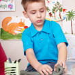 Kid playing with clay. — Foto Stock