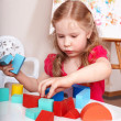 Child preschooler play wood block. — Stock Photo