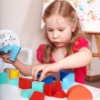 Stock Photo: Child preschooler play wood block.