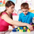 Child with construction in play room. — Stockfoto