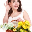 Beautiful girl with  spring flower and hand near ear. — Stock Photo
