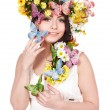 Girl with butterfly and flower on head. — Stock Photo #5736774