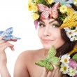 Girl with butterfly and flower on head. — Stock Photo #5736787