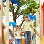 Children on slide outdoor in park. — Stock Photo #5737026