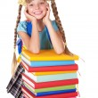 Schoolgirl with backpack holding pile of books. — Zdjęcie stockowe
