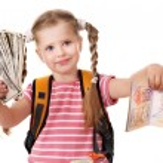 Child holding international passport. — Stock Photo