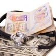 Medical still life with stethoscope, money and passport. — Stock Photo #5737137