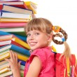 Child with pile of books. — Stock Photo #5737144
