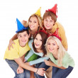 Stok fotoğraf: Group of young in party hat.