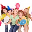 Photo: Group of young in party hat.