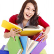 Girl with pile color book . - Stock Photo