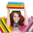 Girl with stack color book. — Stock Photo #5737543