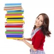 Girl holding stack color book . — Stock Photo #5737548
