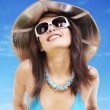 Girl in bikini and sunglasses on beach. — Stock Photo #5737570