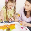 Child painting in preschool. — Stock Photo #5737618
