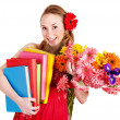 Stock Photo: Young woman holding flowers and books.