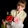 Child holding flowers and gas mask . — Stock Photo #5737716