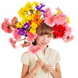 Child with with flowers on her hair. — Stock Photo #5737731