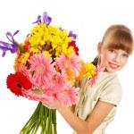Happy child holding flowers. — Stock Photo #5737732