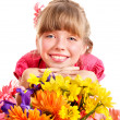 Happy child holding flowers. — Stock Photo #5737754
