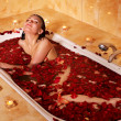 Woman relaxing in bath. - Stock Photo