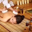 Royalty-Free Stock Photo: Woman getting massage in bamboo spa.