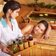 Woman getting massage in bamboo spa. - ストック写真