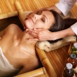 Woman getting massage in bamboo spa. — Stock Photo #5738144
