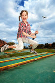Little girl playing golf in park. — Stock Photo