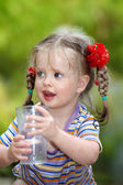 Child drinking glass of water. — Stock Photo
