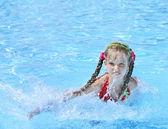 Child swim in swimming pool. — Stock Photo