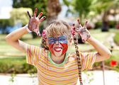 Child with face painting. — Stock Photo
