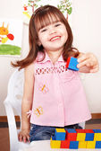 Child playing block in play room. — Stock Photo