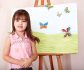 Child with easel in preschool. — Stock Photo