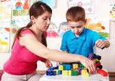 Child with construction in play room. — Stock Photo
