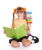 Schoolgirl reading pile of books. — Stockfoto