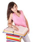 Girl with pile colored book . — Стоковое фото