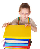 Child reading pile of books. — Stock Photo