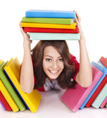 Girl with stack color book. — Stock Photo