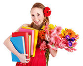 Young woman holding flowers and books. — Stock Photo